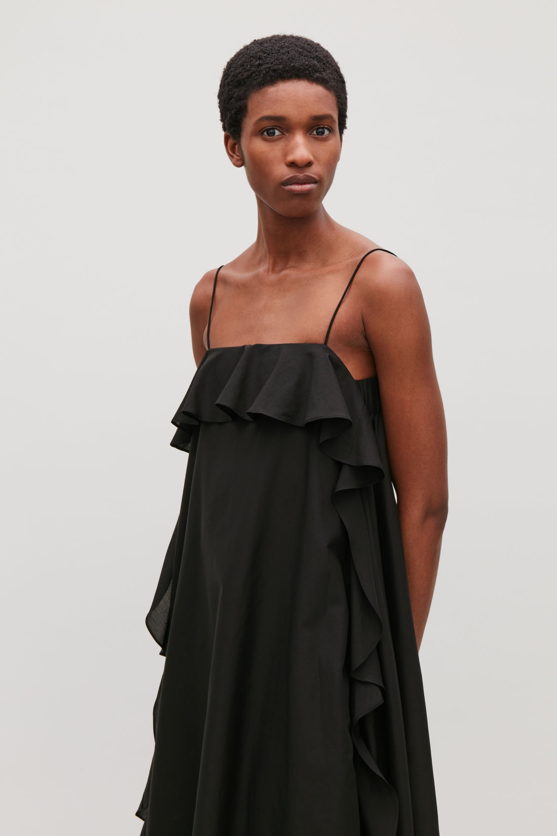 Model side image of Cos frilled cotton-silk dress in black