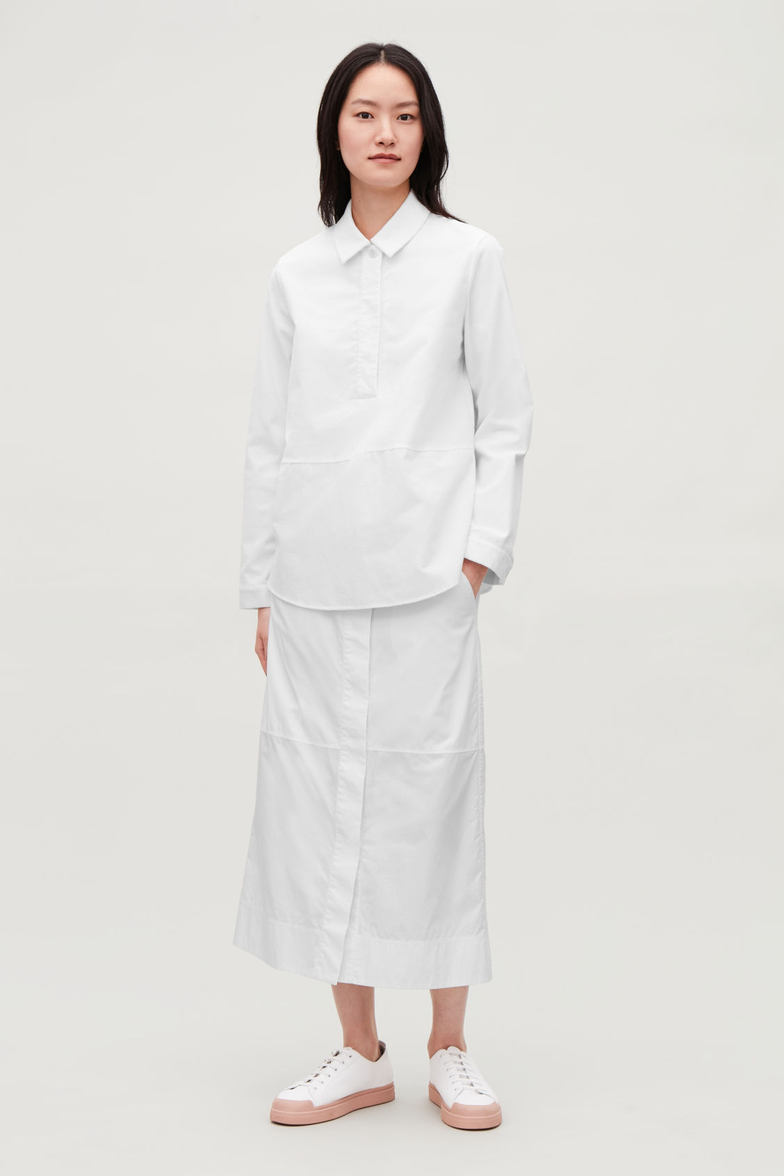 Model front image of Cos long skirt with folded waistband  in white