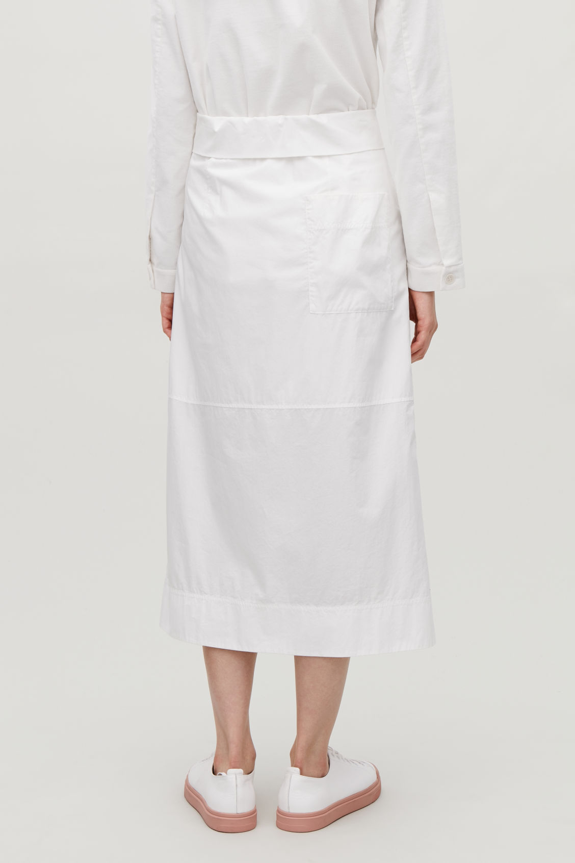 Model side image of Cos long skirt with folded waistband  in white