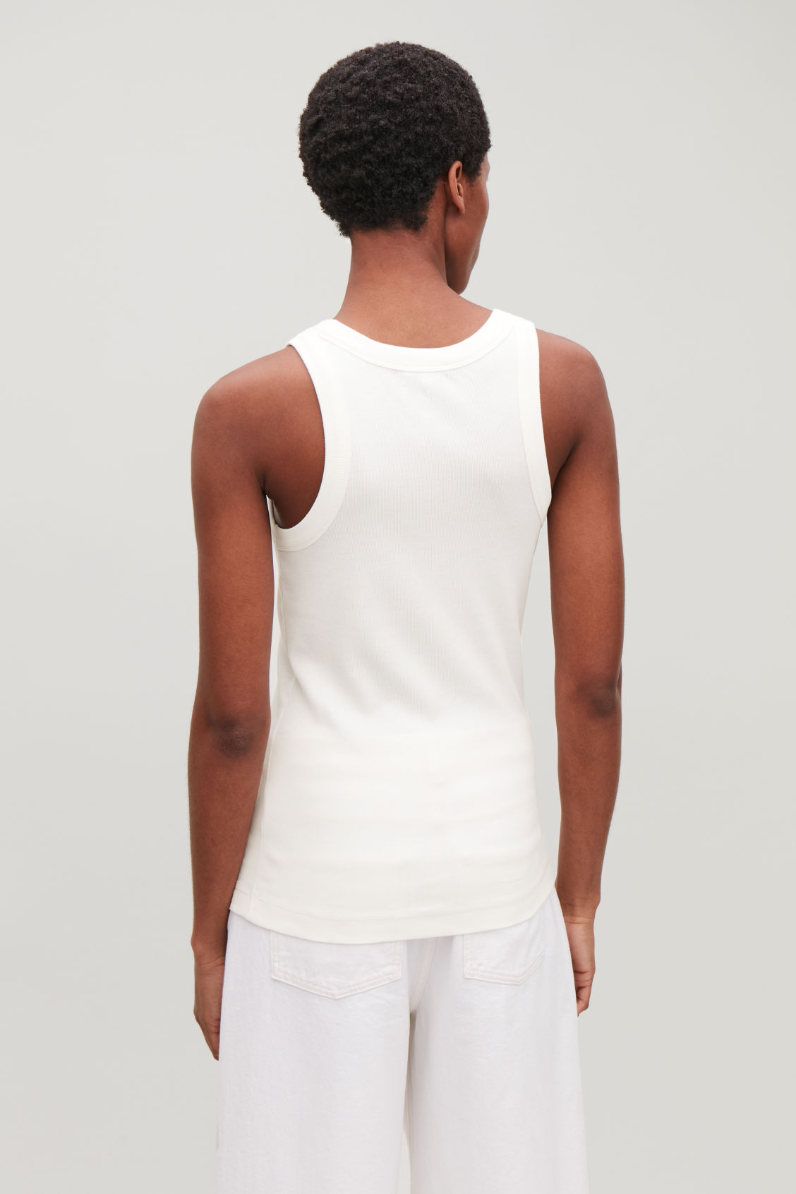 Model side image of Cos ribbed jersey vest top in white
