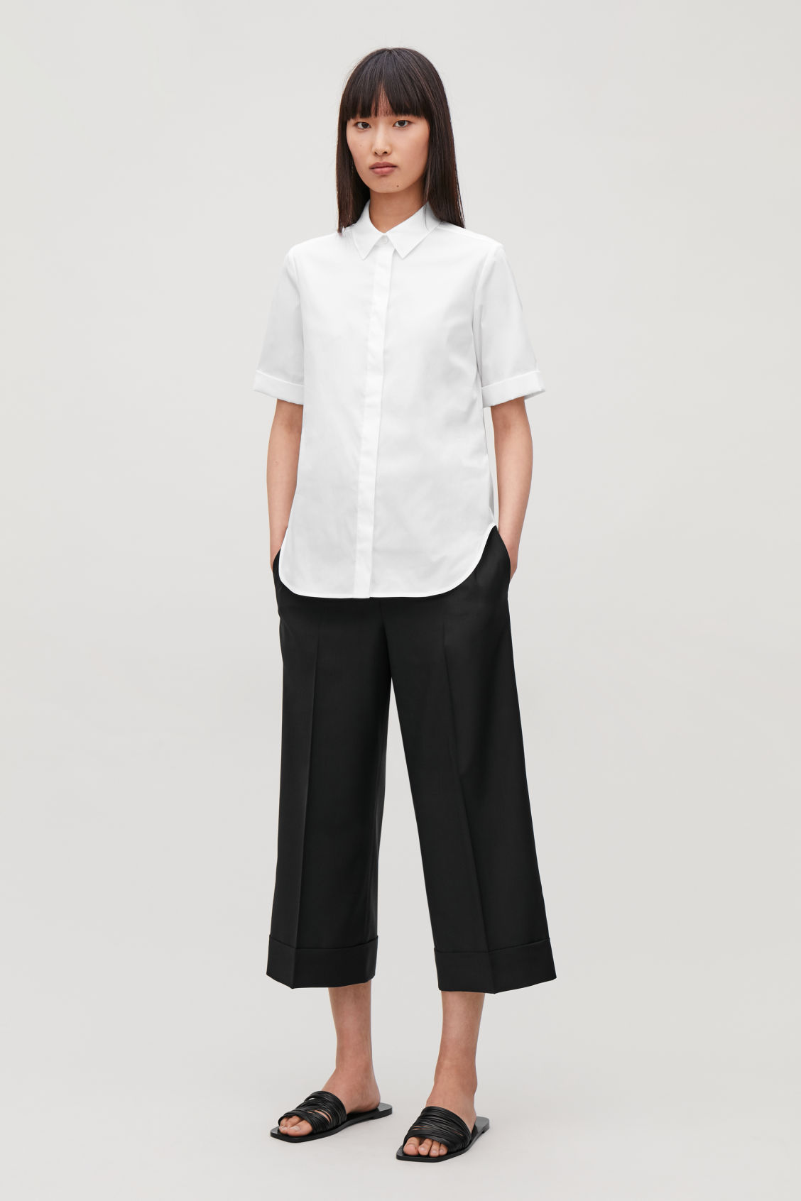 Model front image of Cos slim shirt with turn-up sleeves in white