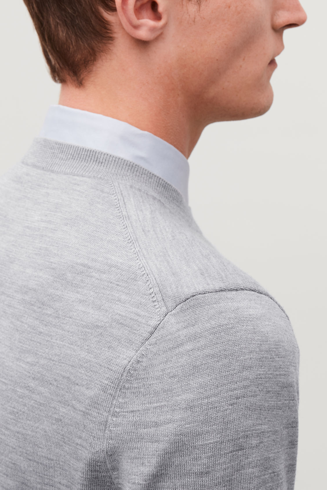 Model side image of Cos merino wool jumper in grey