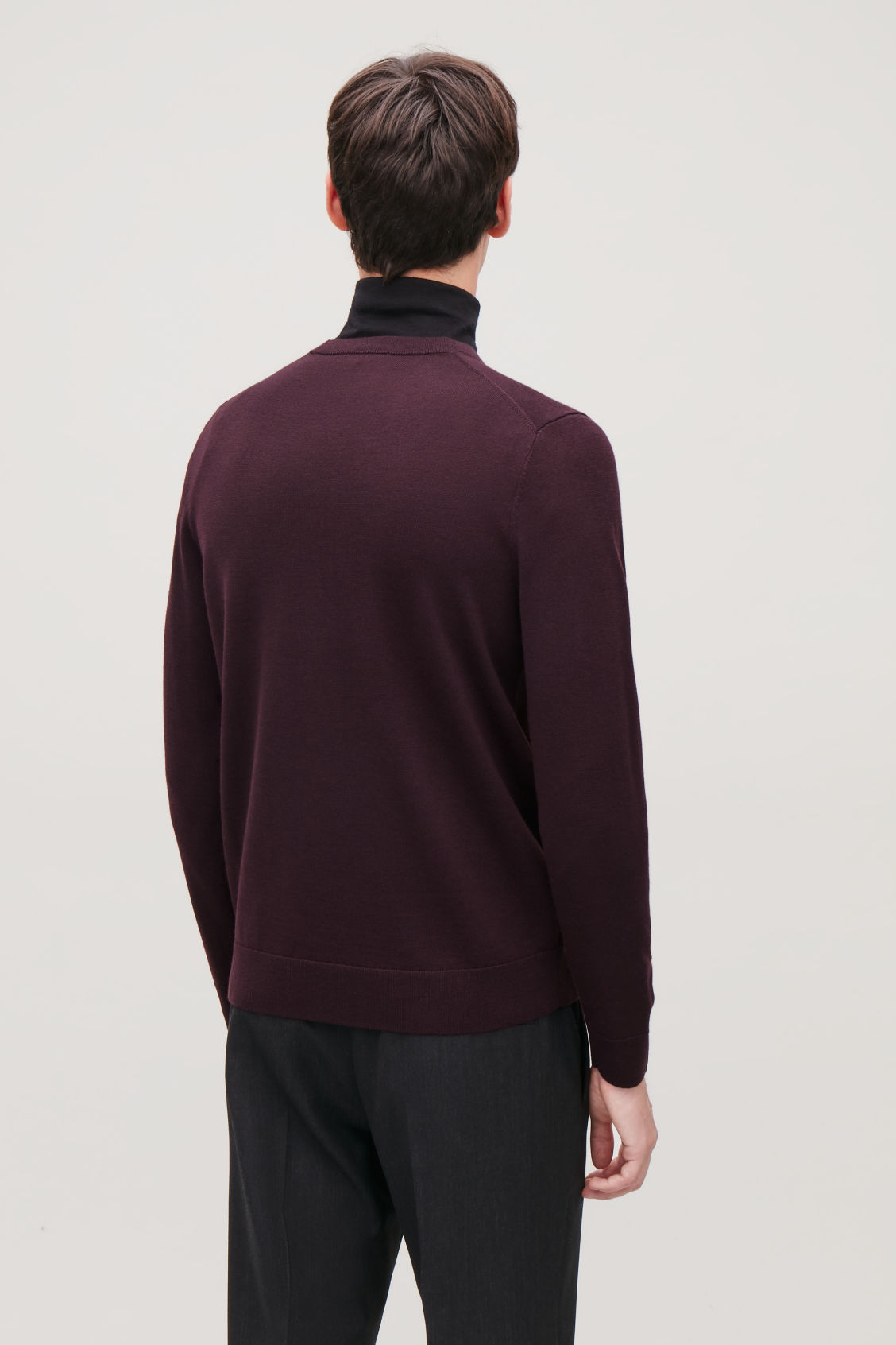 Model side image of Cos merino wool jumper in red