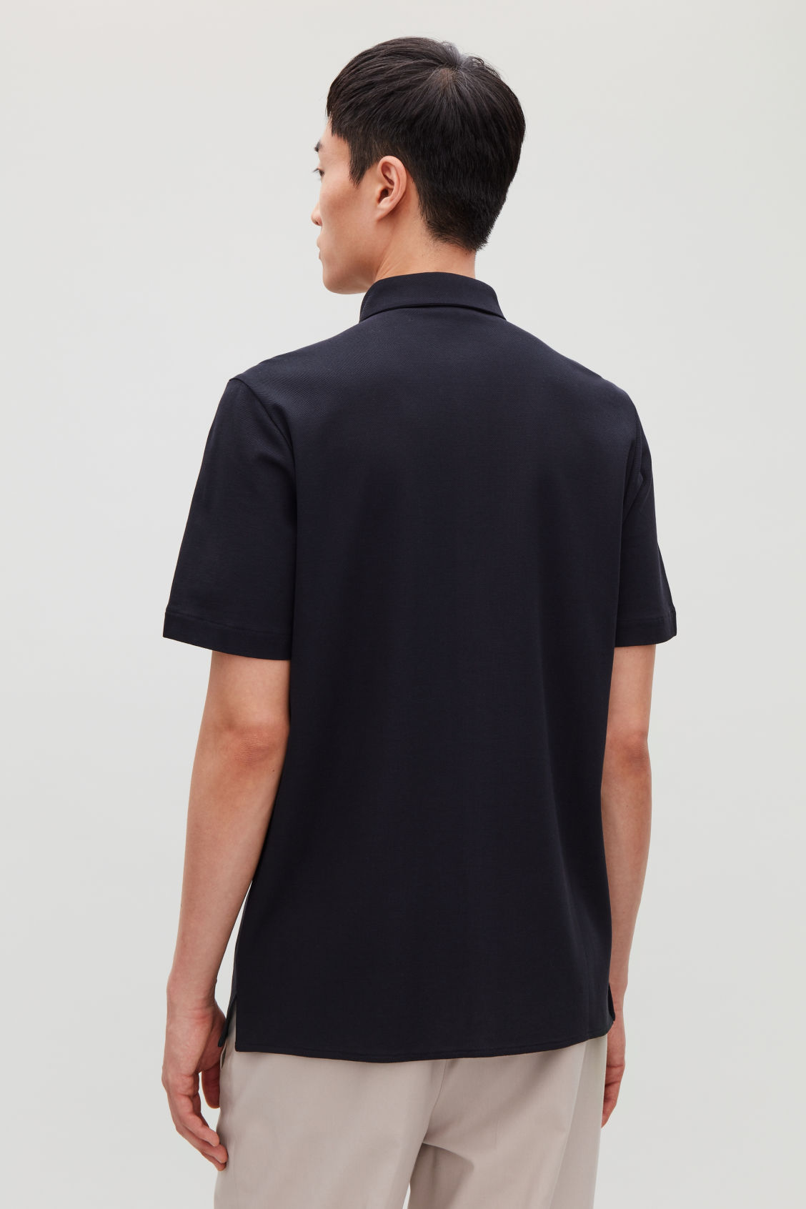 Model side image of Cos short-sleeved pique shirt in blue