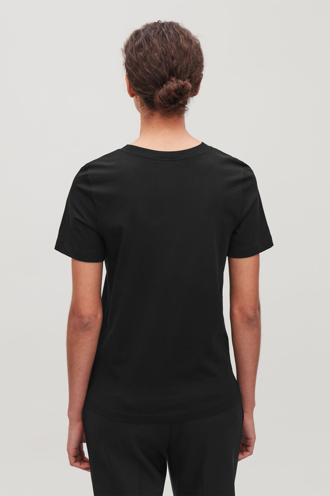 Model side image of Cos cotton t-shirt in black