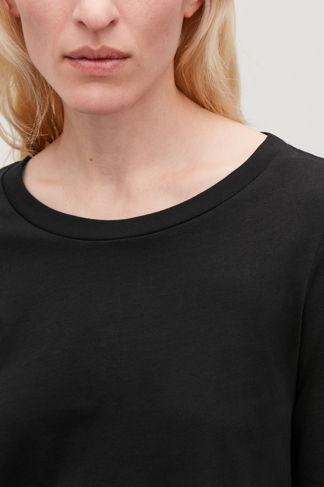 Model side image of Cos ¾-sleeved cotton top in black