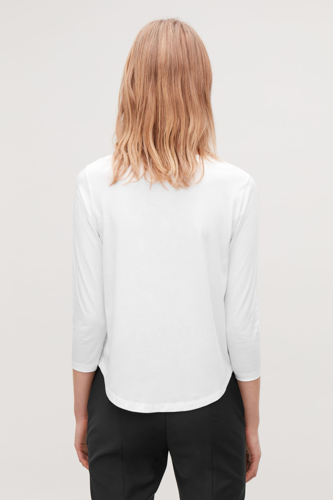 Model side image of Cos ¾-sleeved cotton top in white
