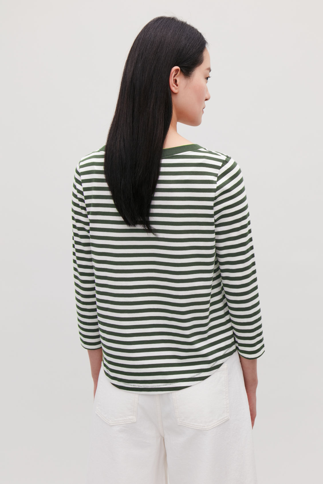 Model side image of Cos ¾-sleeved cotton top in green