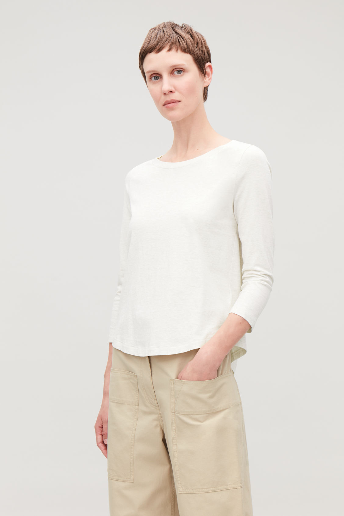Model side image of Cos ¾-sleeved cotton top in beige