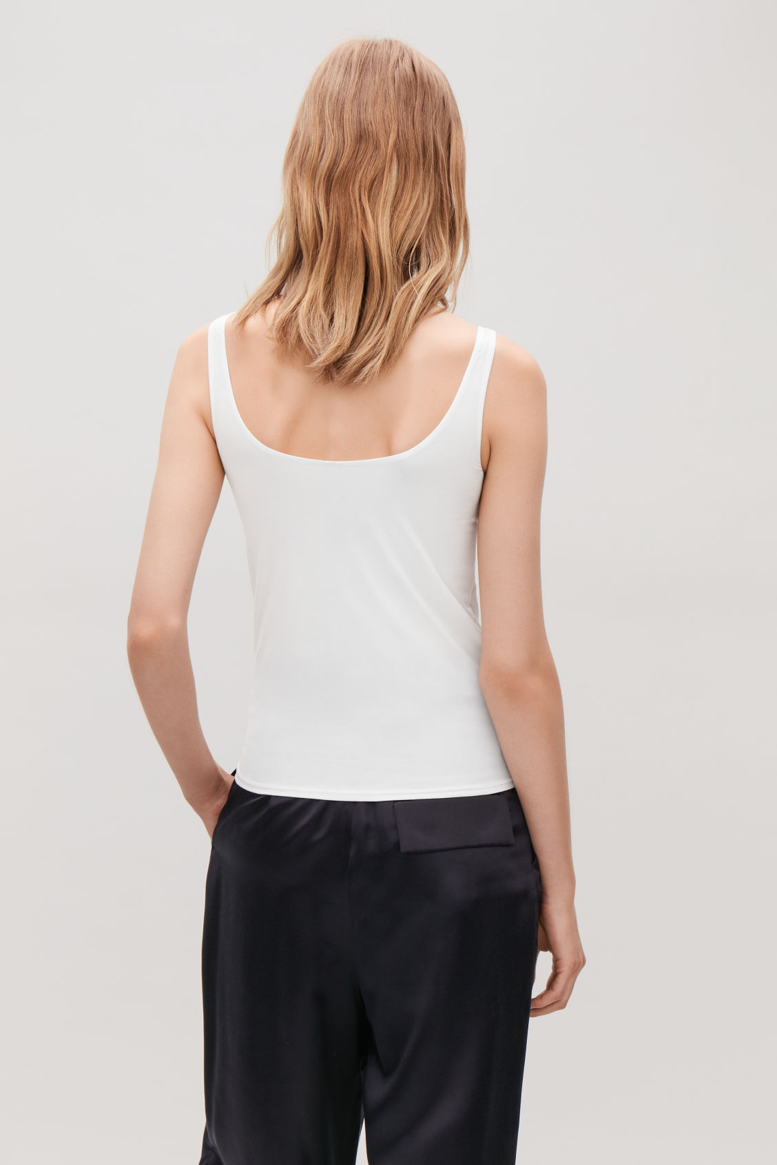 Model side image of Cos stretch-cotton vest top in white