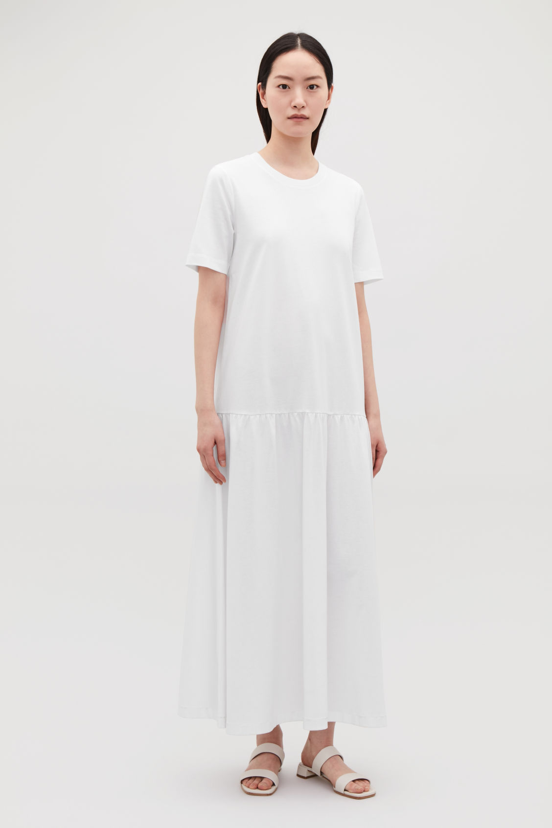 Model front image of Cos long cotton dress with frilled hem in white