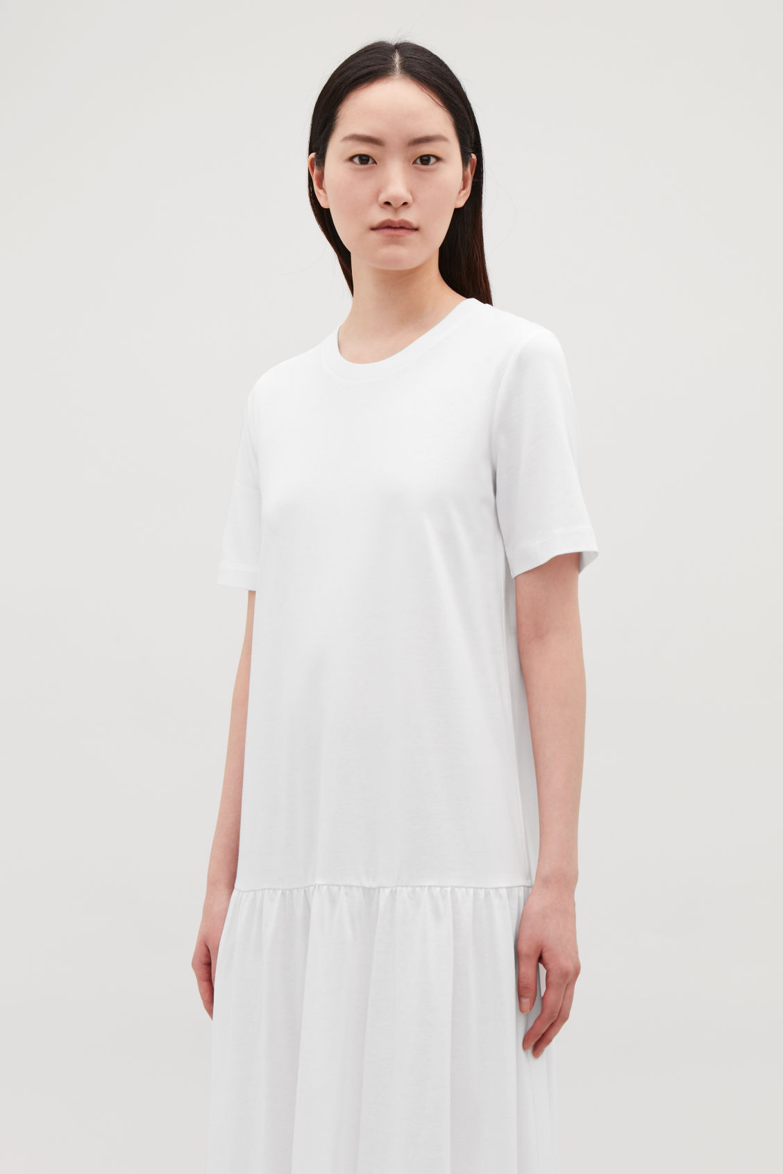 Model side image of Cos long cotton dress with frilled hem in white