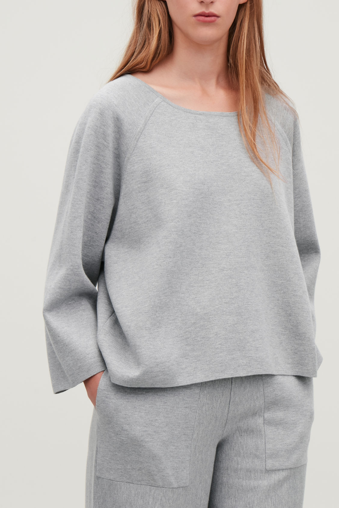 Model side image of Cos cotton-cashmere knit top in grey