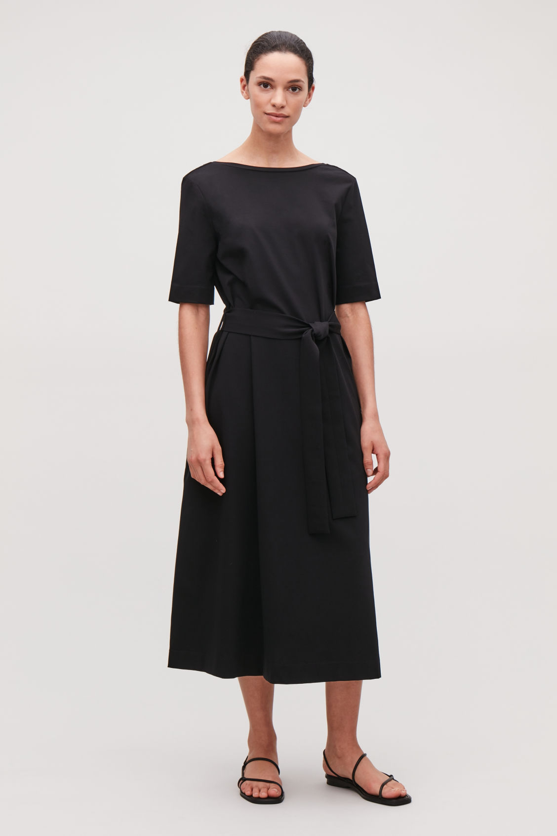 Model front image of Cos long a-line jersey dress in black