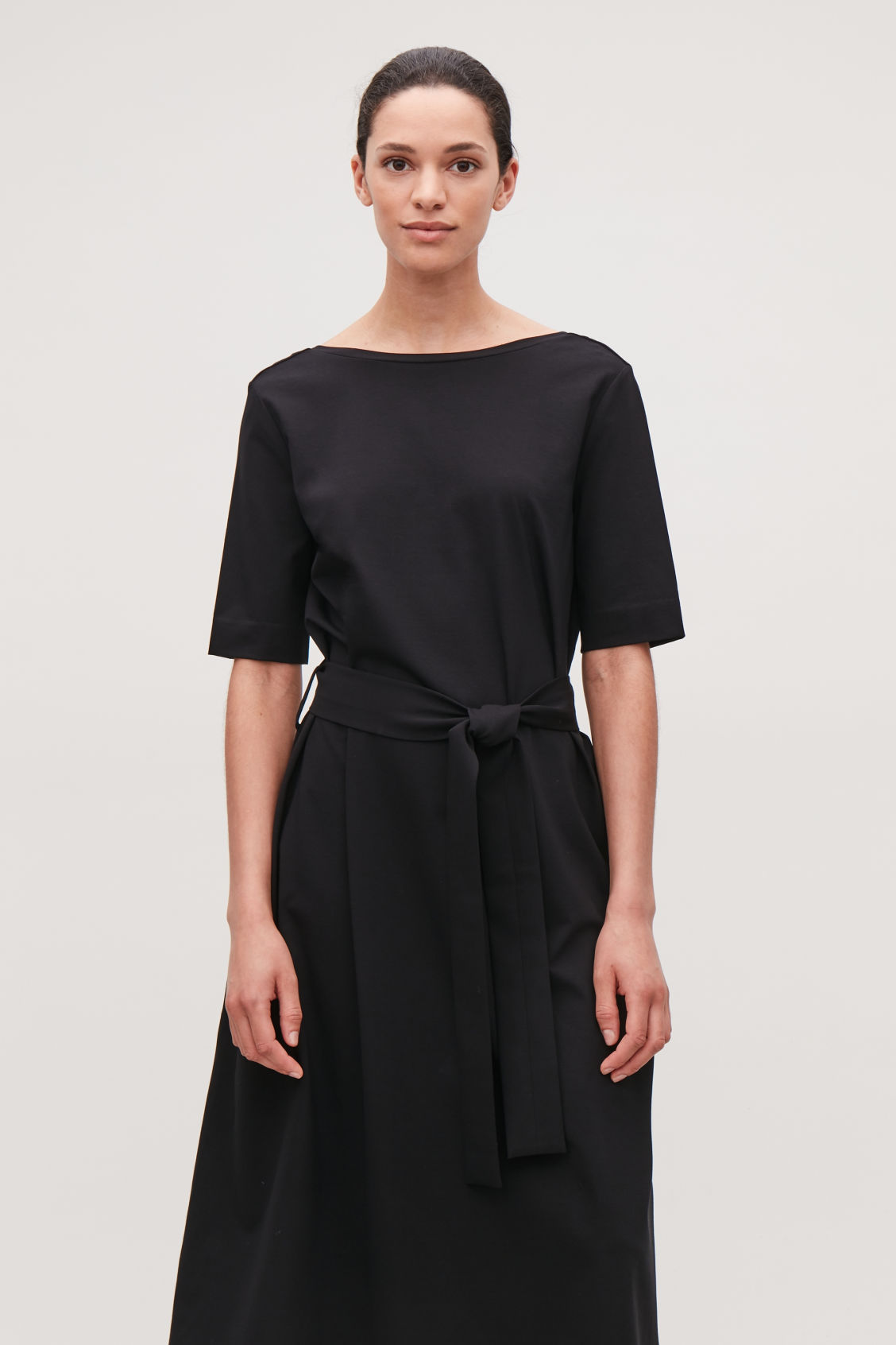 Model side image of Cos long a-line jersey dress in black