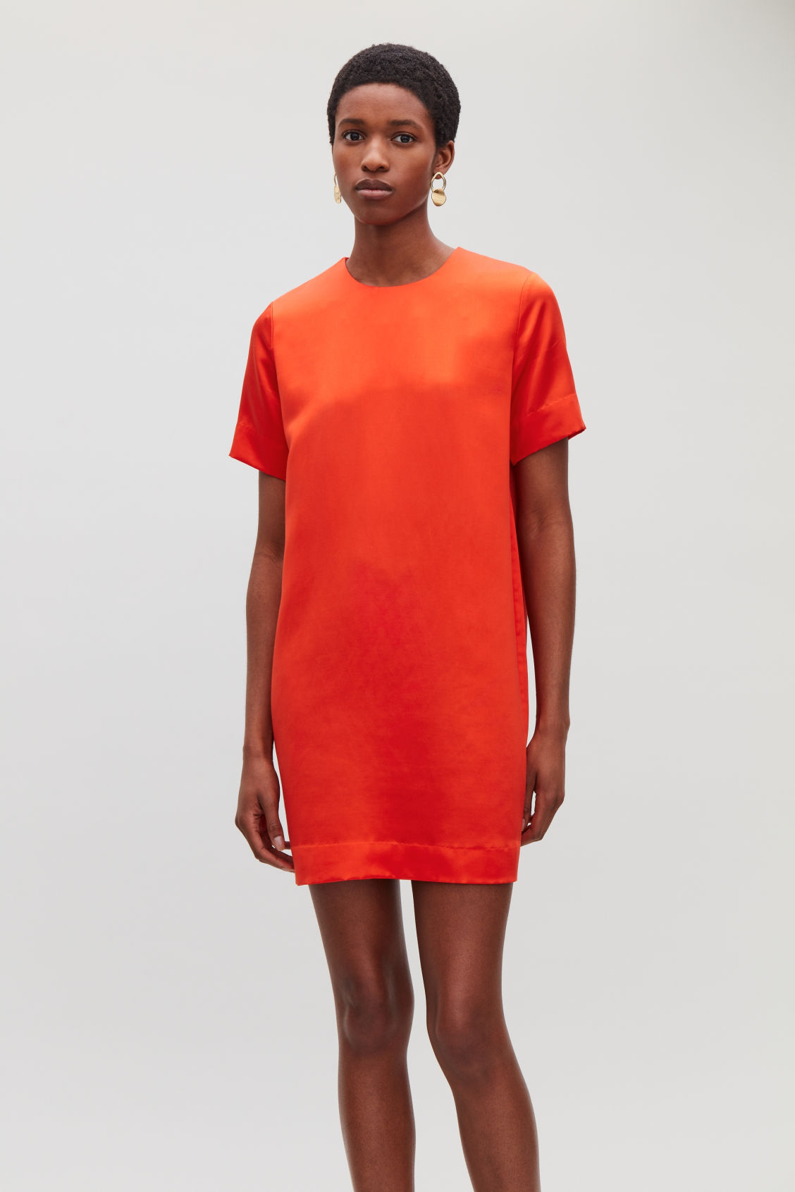 Model side image of Cos short silk-blend dress in orange