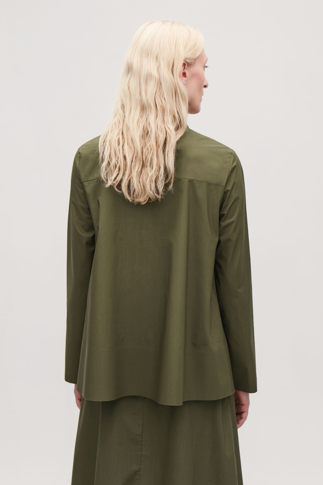 Model side image of Cos cotton-poplin a-line shirt in green