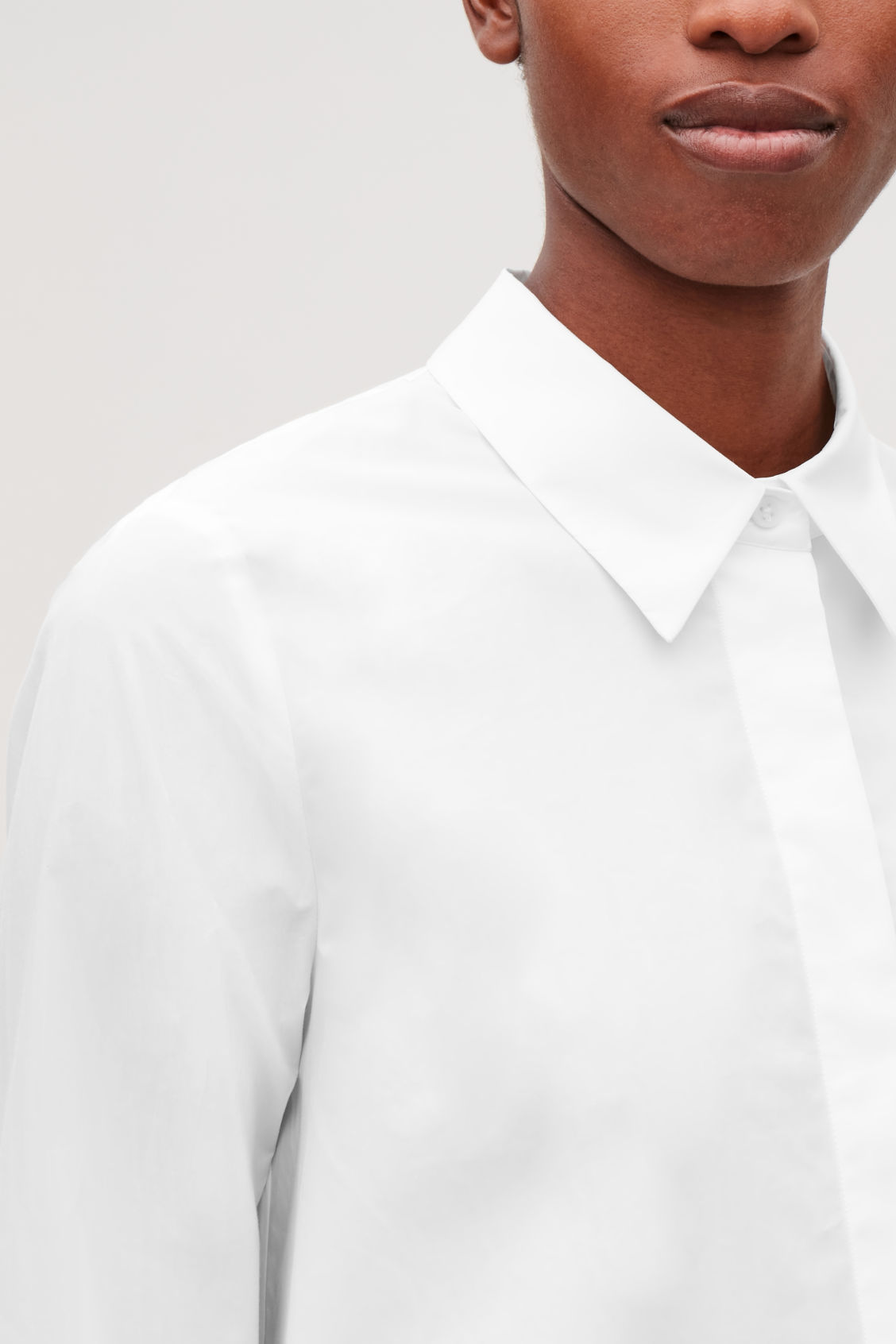 Model side image of Cos cotton-poplin a-line shirt in white