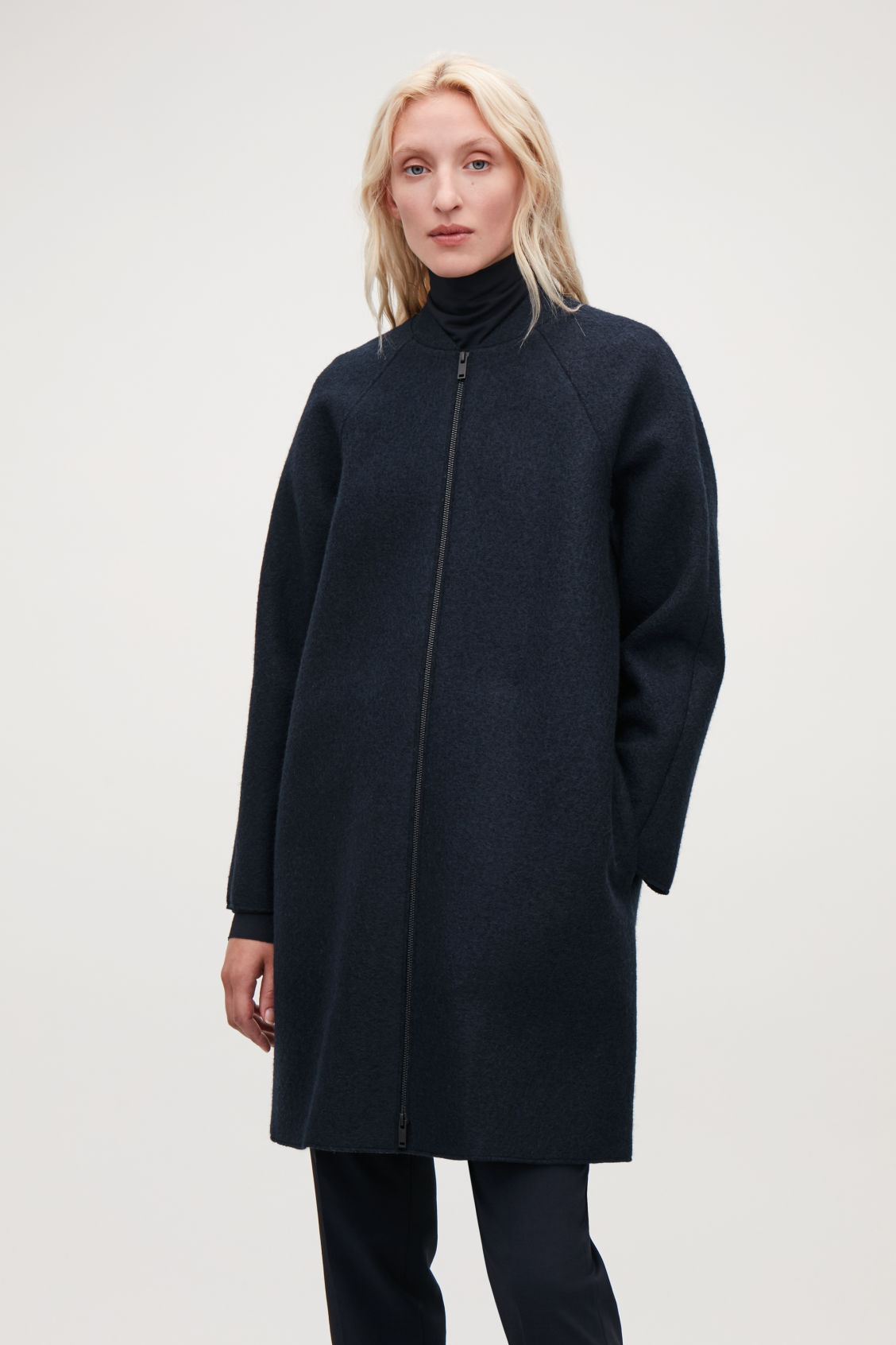 Model side image of Cos boiled-wool cocoon coat in blue