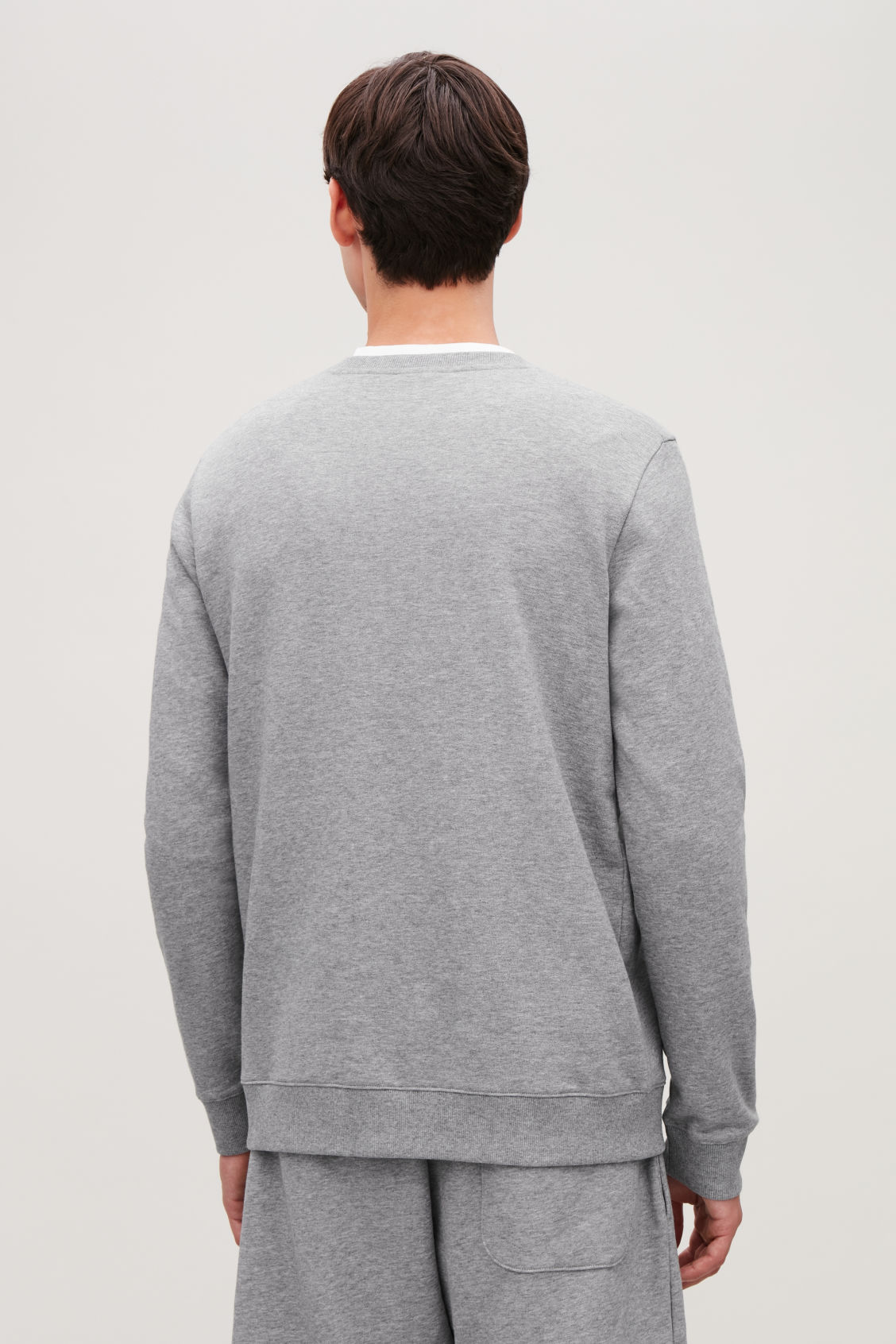 Model side image of Cos brushed cotton sweatshirt in grey