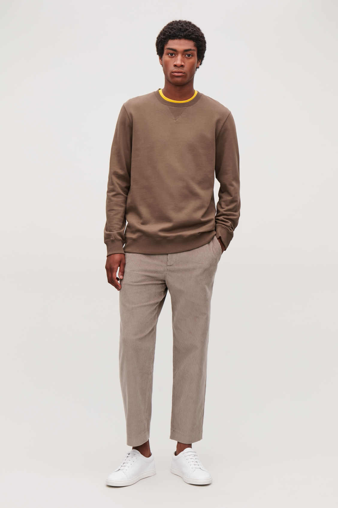 Model side image of Cos brushed cotton sweatshirt in brown