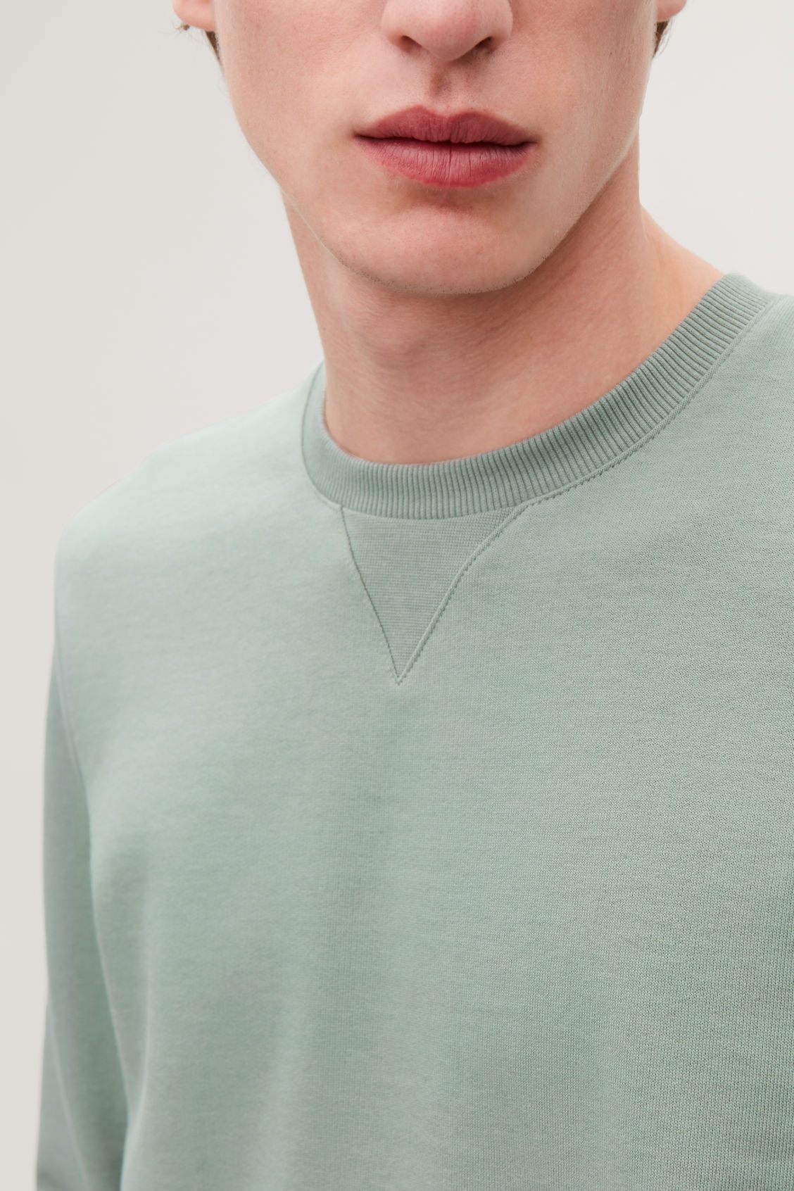 Model side image of Cos brushed cotton sweatshirt in green