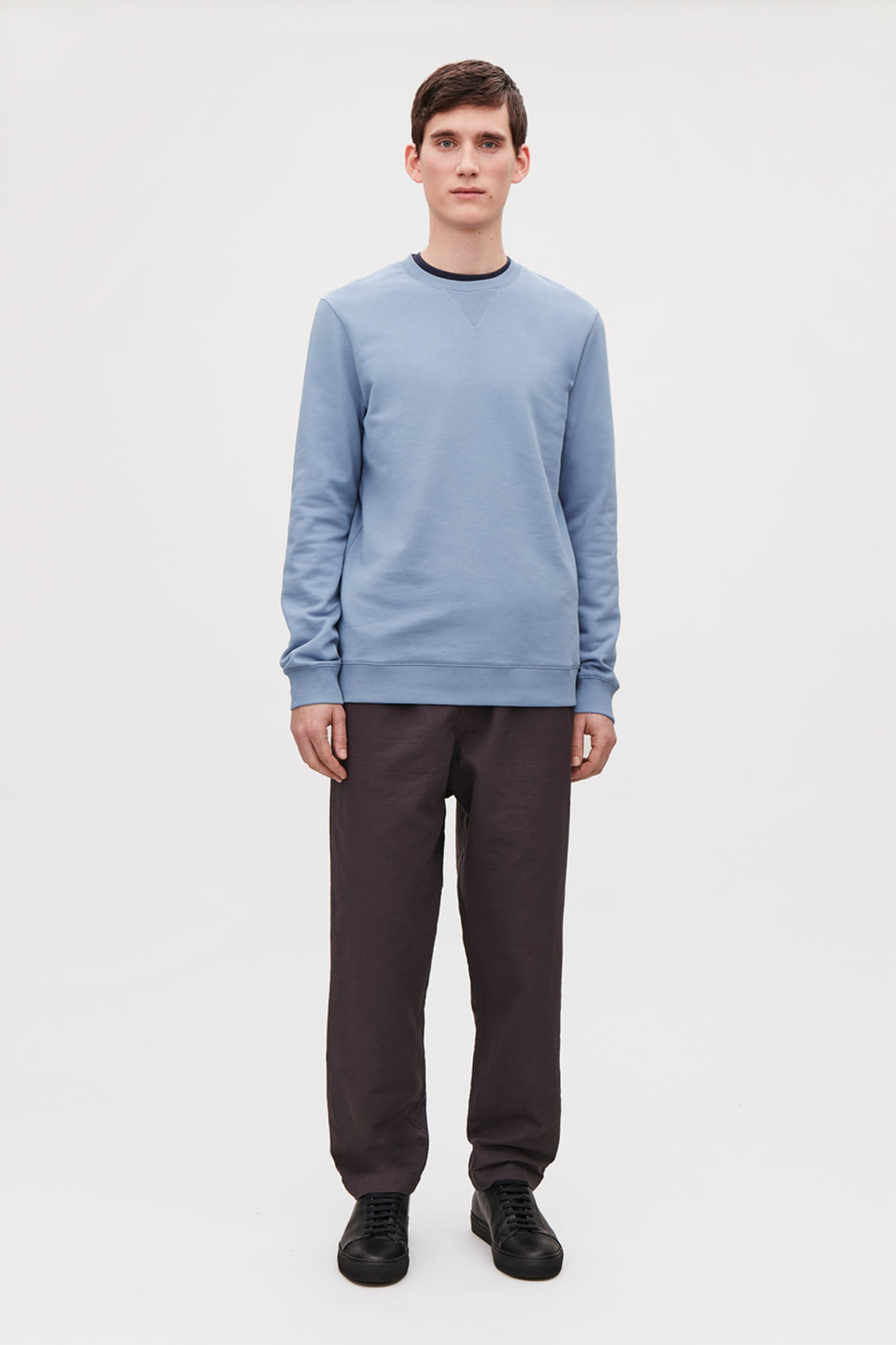 Model front image of Cos brushed cotton sweatshirt in blue