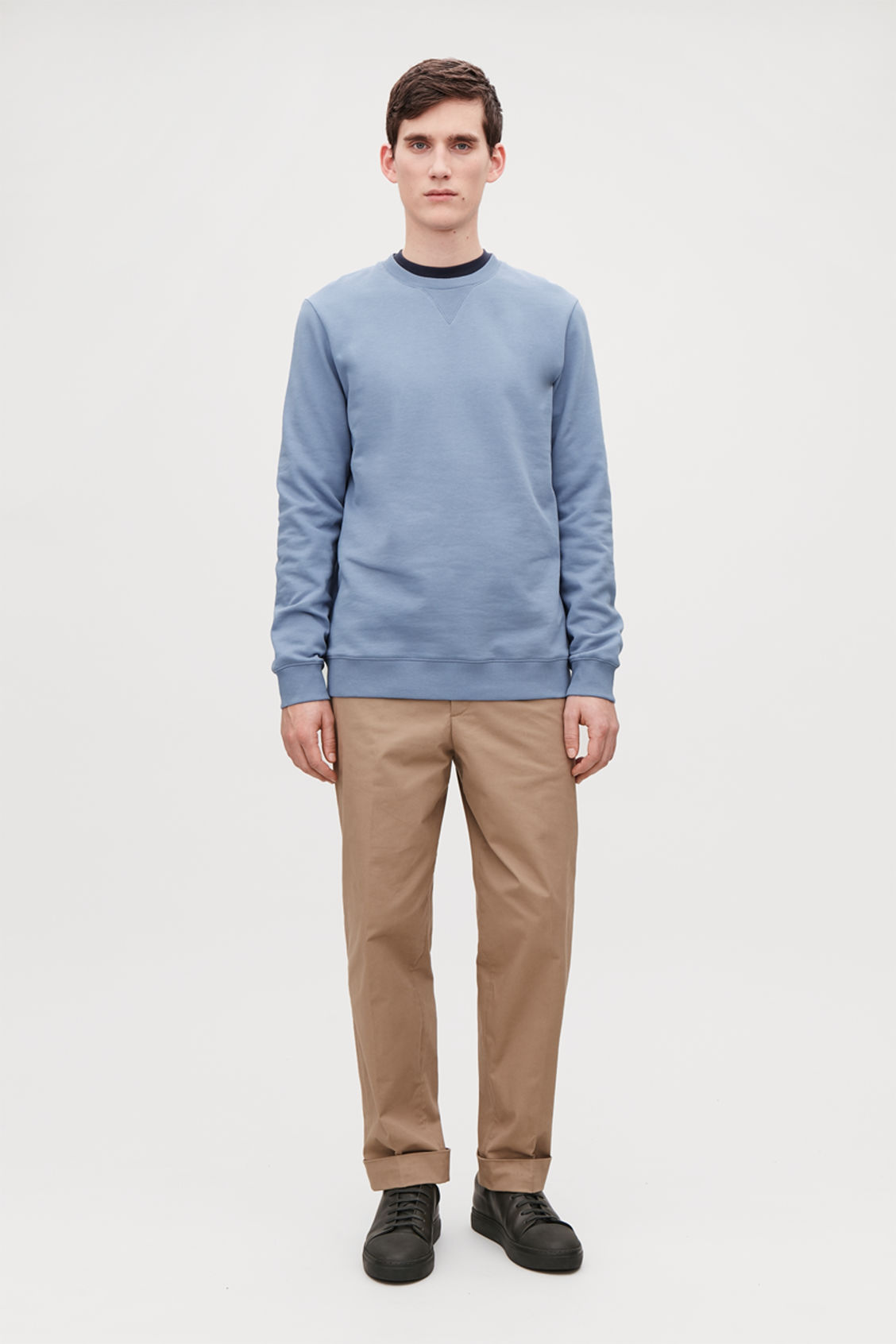 Model side image of Cos brushed cotton sweatshirt in blue