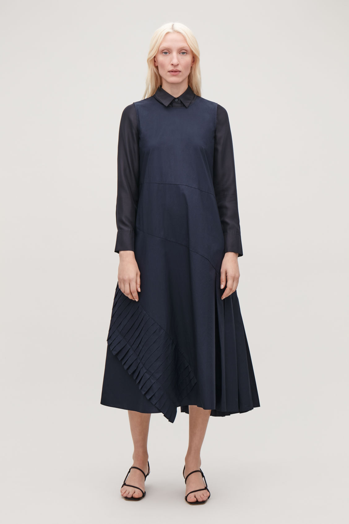 Model side image of Cos a-line dress with pleated drape in blue