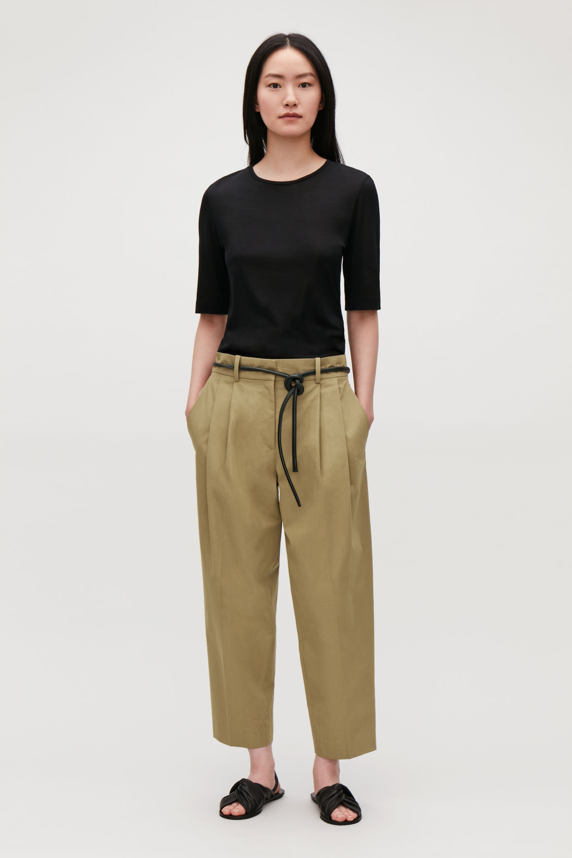 Model front image of Cos wide tapered trousers in beige
