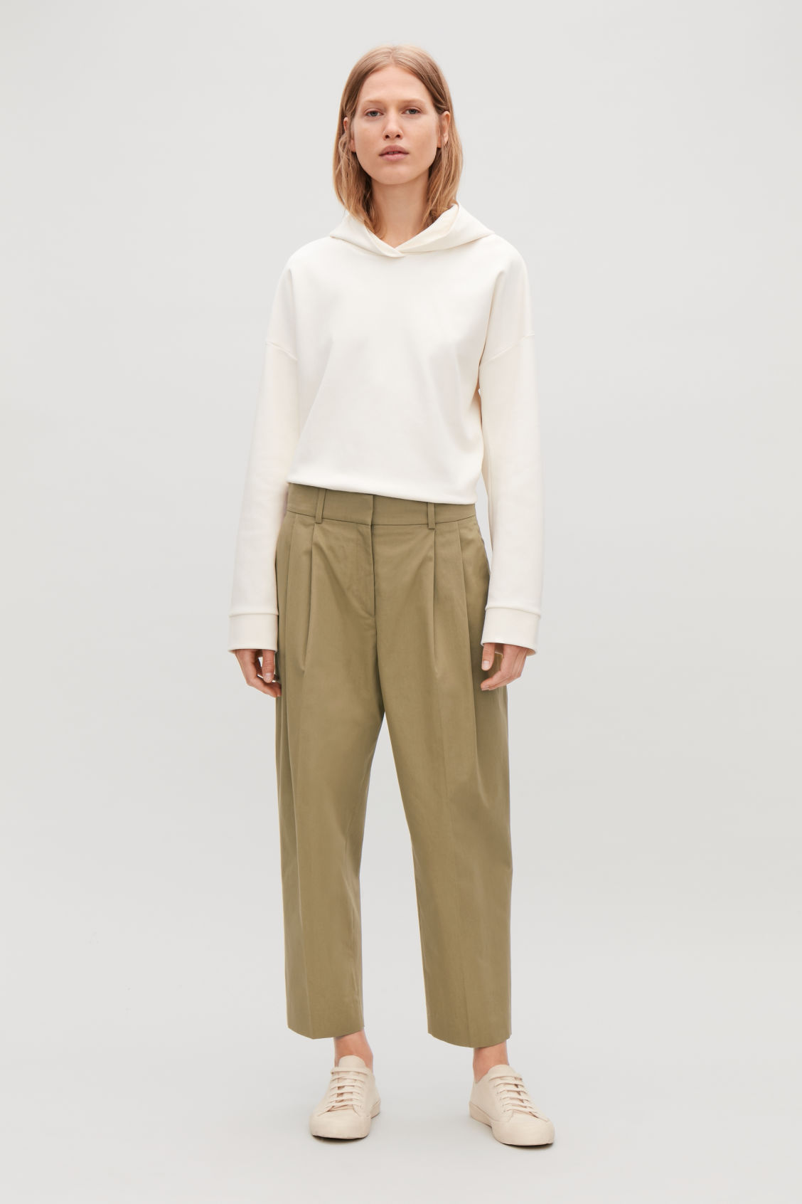 Model side image of Cos wide tapered trousers in beige