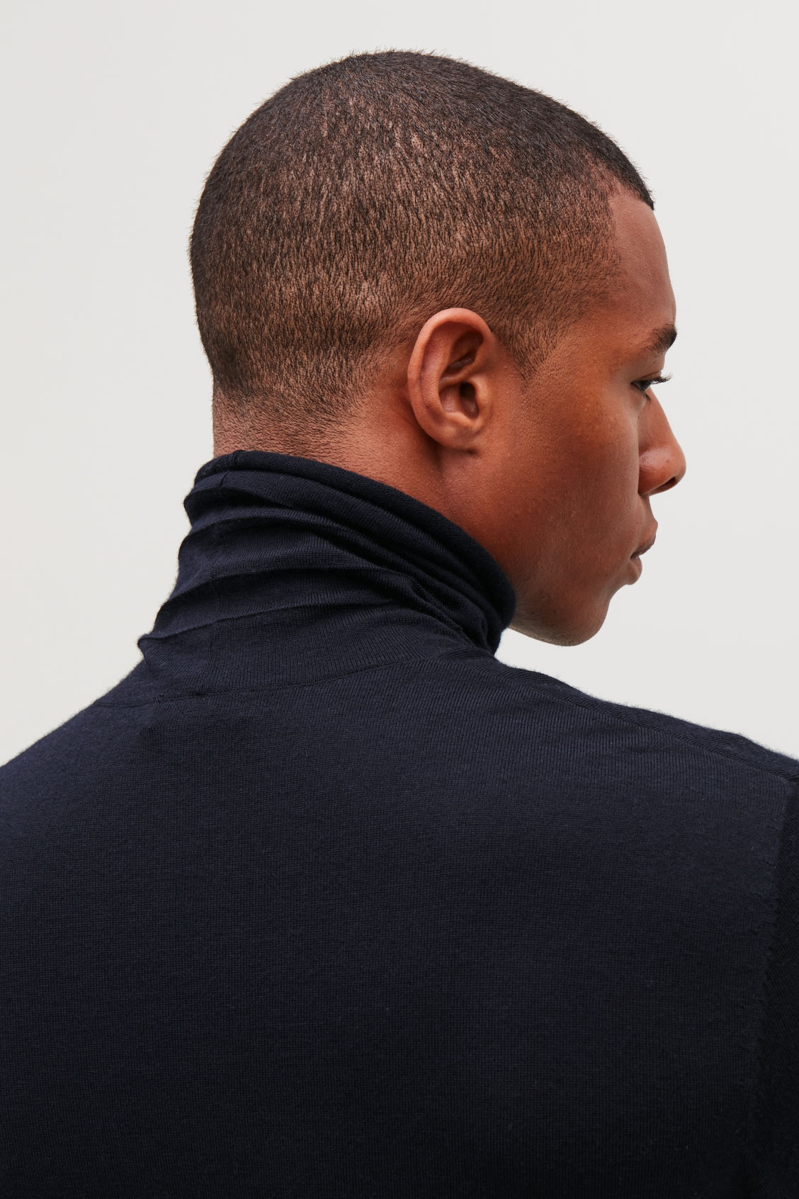 Model side image of Cos reverse-stitched wool jumper in blue