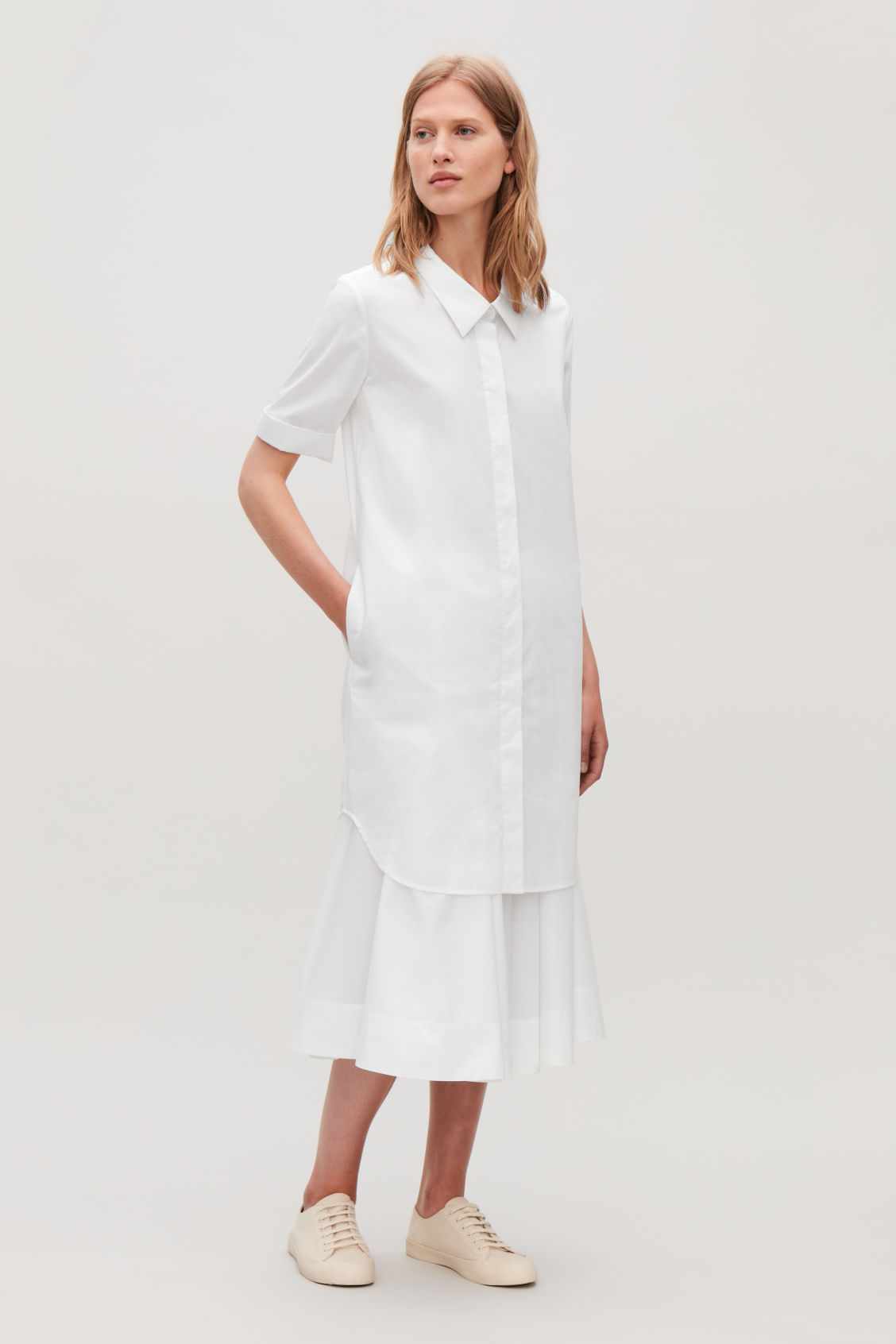 Model side image of Cos shirt dress with dropped collar in white