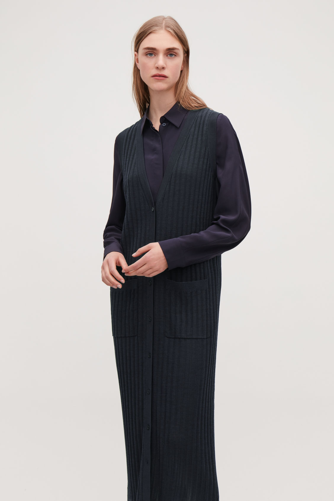 Model side image of Cos ribbed-knit wool dress in blue