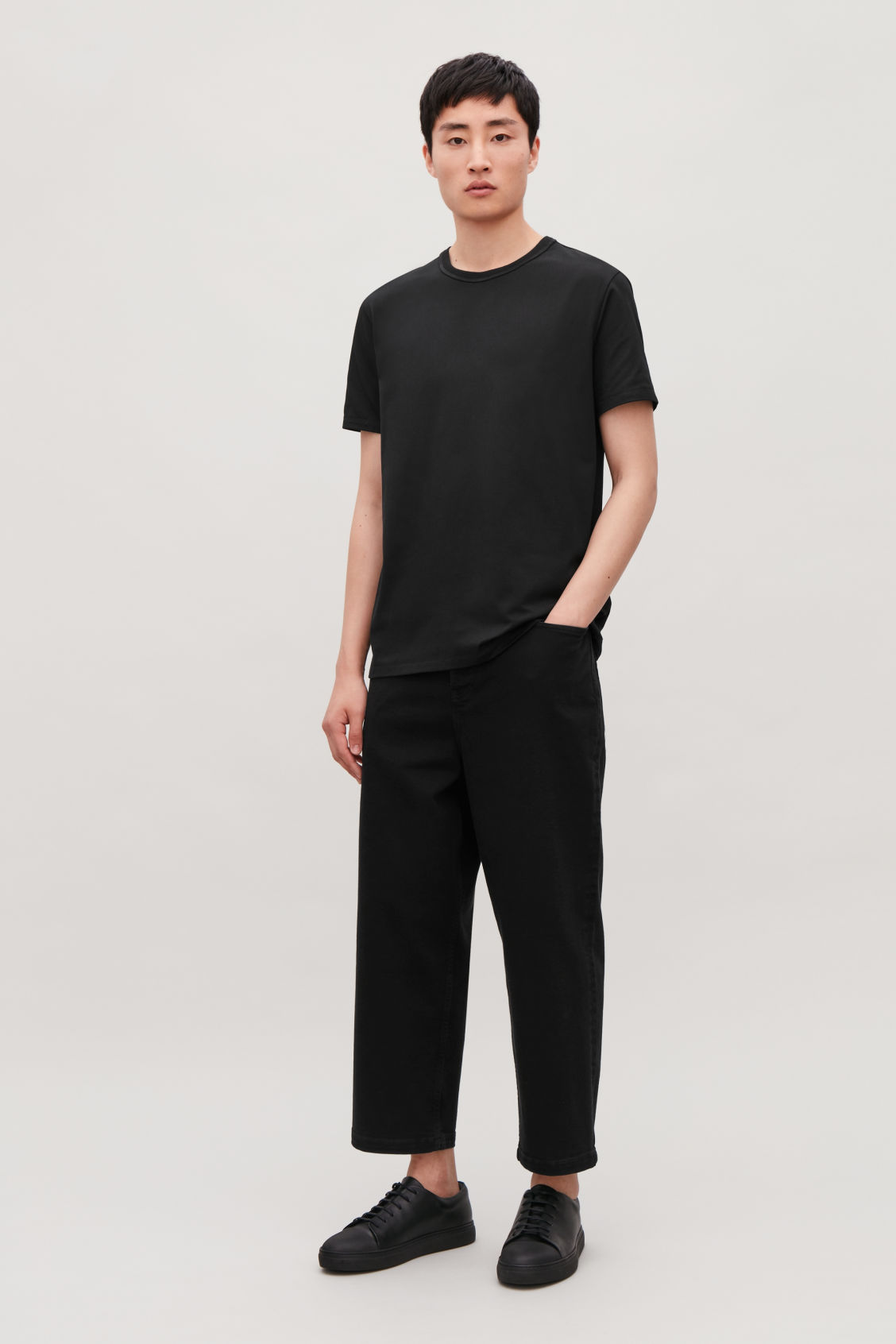 Model front image of Cos ribbed-neck cotton t-shirt in black