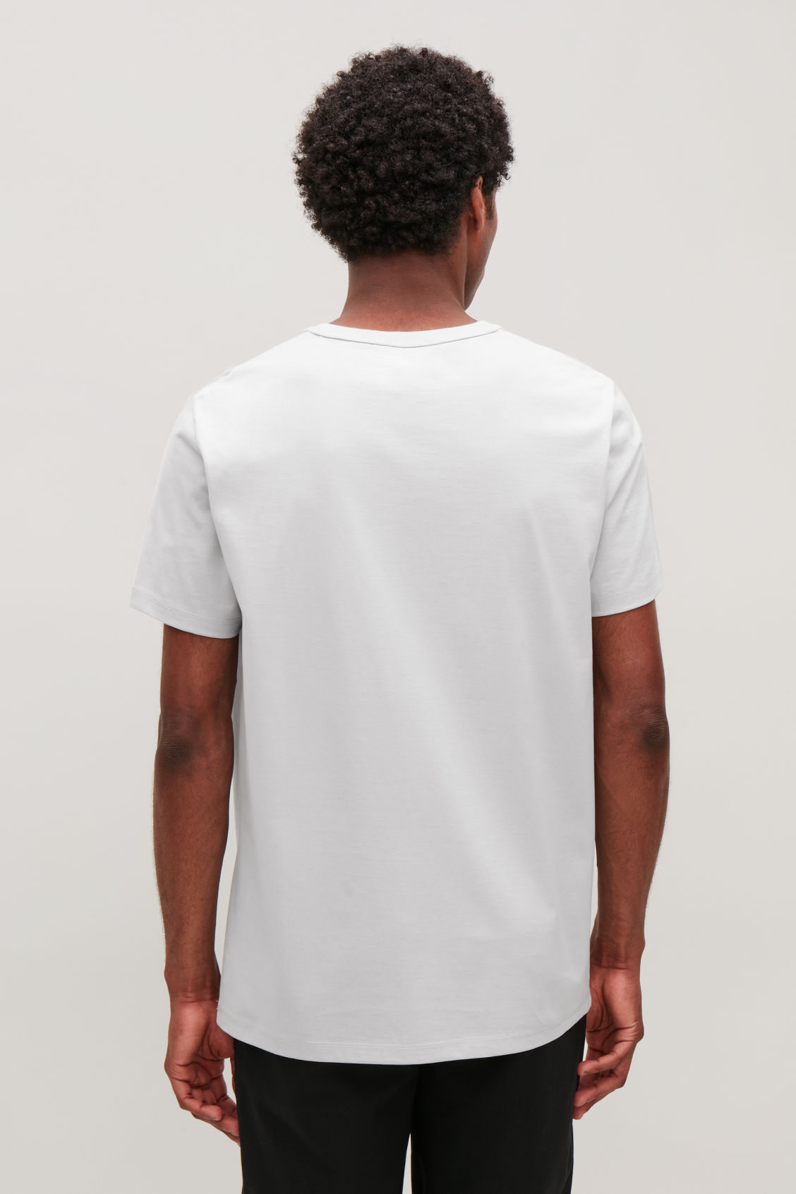Model side image of Cos ribbed-neck cotton t-shirt in grey