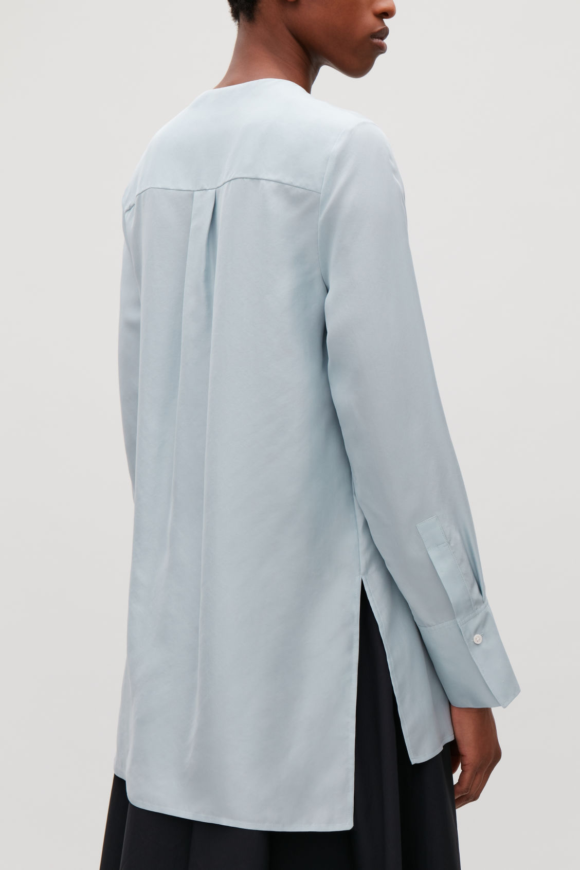 Model side image of Cos collarless tunic silk shirt in blue