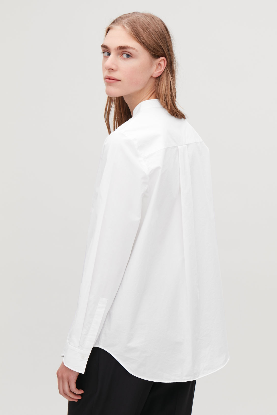 Model side image of Cos grandad-collared cotton shirt in white