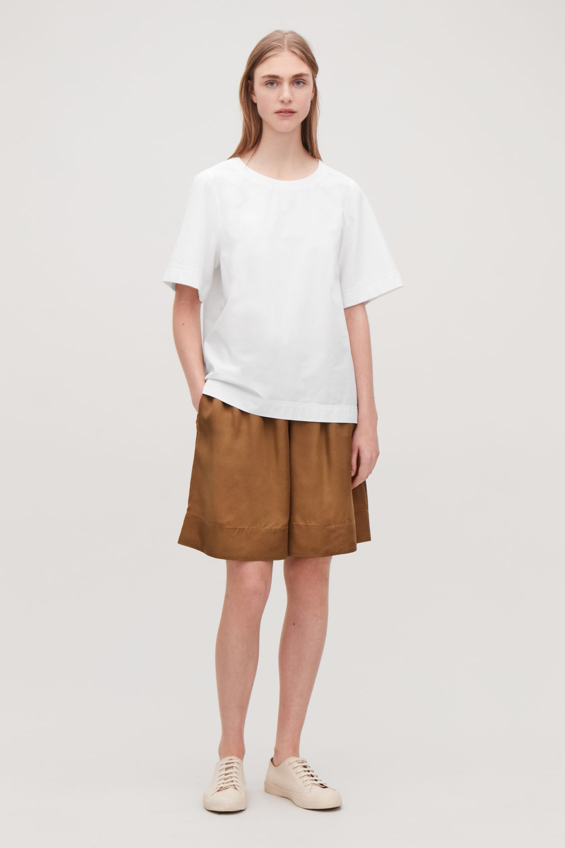 Model front image of Cos top with textured sleeves in white