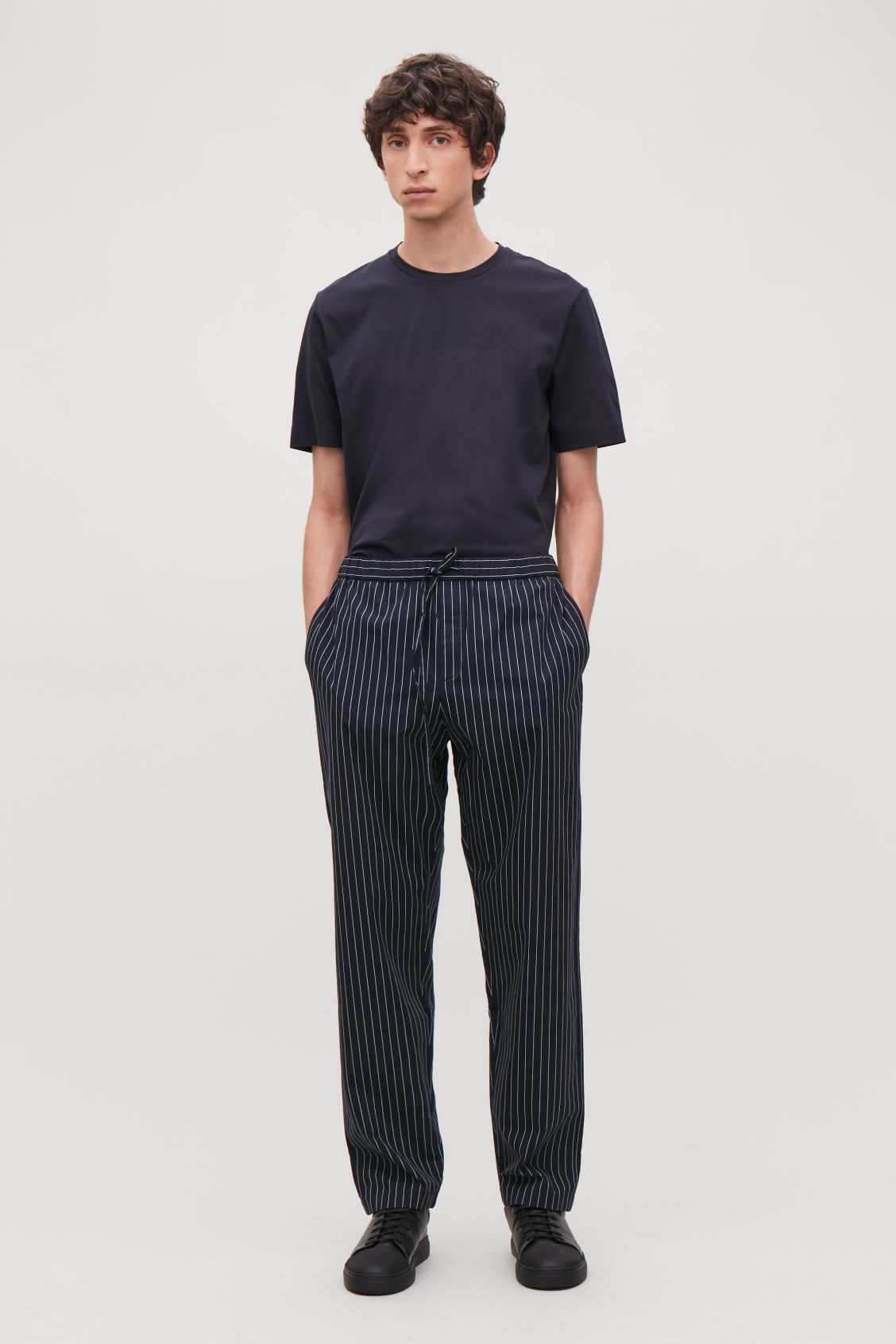 Model front image of Cos pinstriped pyjama trousers in blue