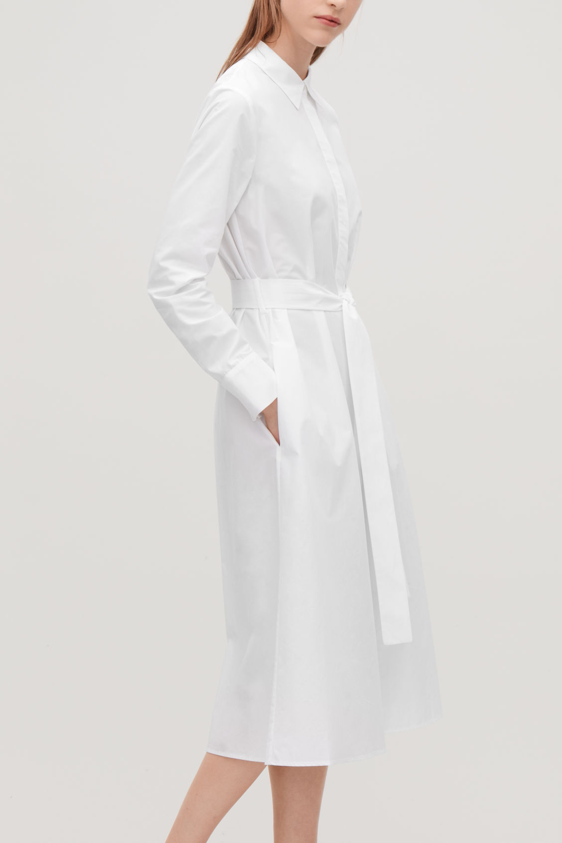 Model side image of Cos pleated-back shirt dress in white