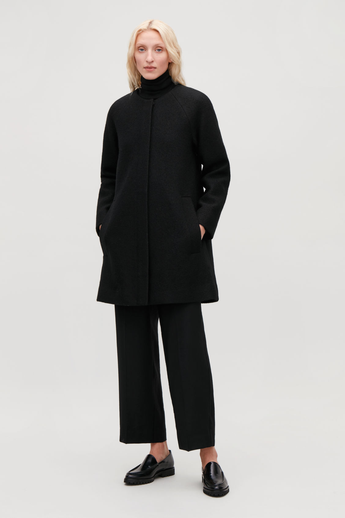 Model front image of Cos a-line wool coat with pockets in black