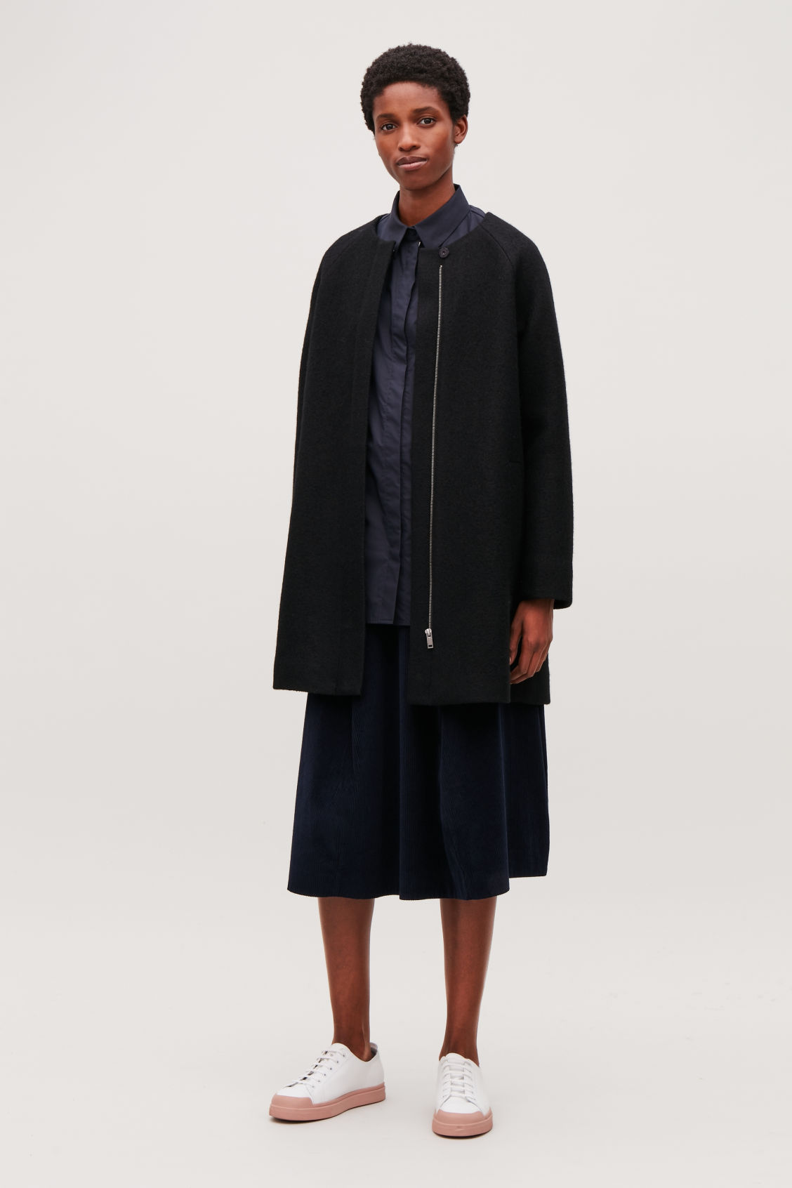 Model side image of Cos a-line wool coat with pockets in black