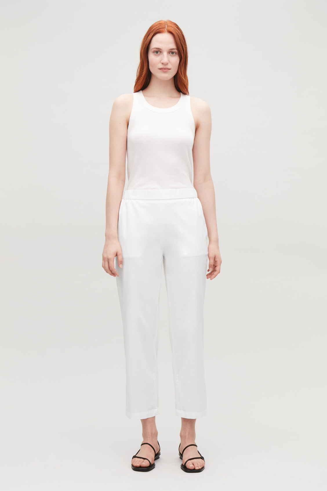 Model front image of Cos cropped cotton poplin trousers in neutral