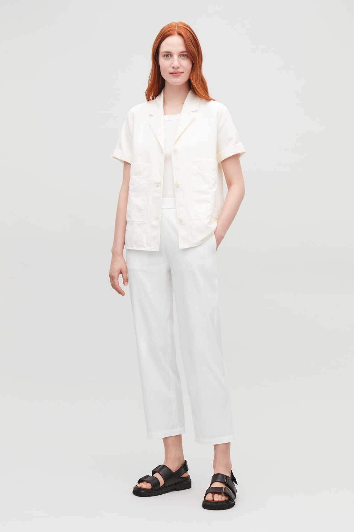 Model side image of Cos cropped cotton poplin trousers in neutral