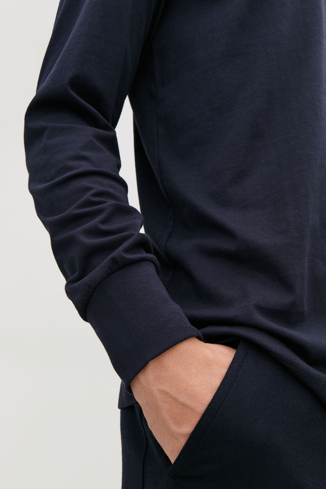 Model side image of Cos basic long-sleeved t-shirt in blue
