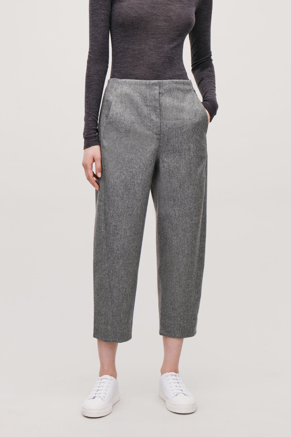 Model side image of Cos twisted-seam wool trousers in grey