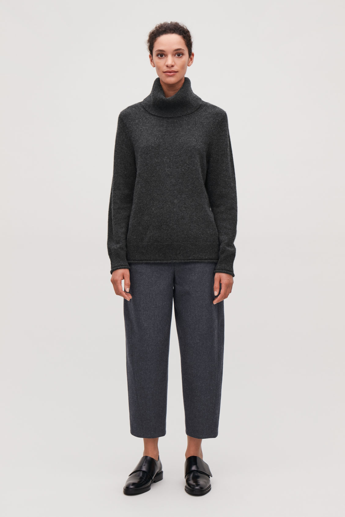 Model front image of Cos twisted-seam wool trousers in grey