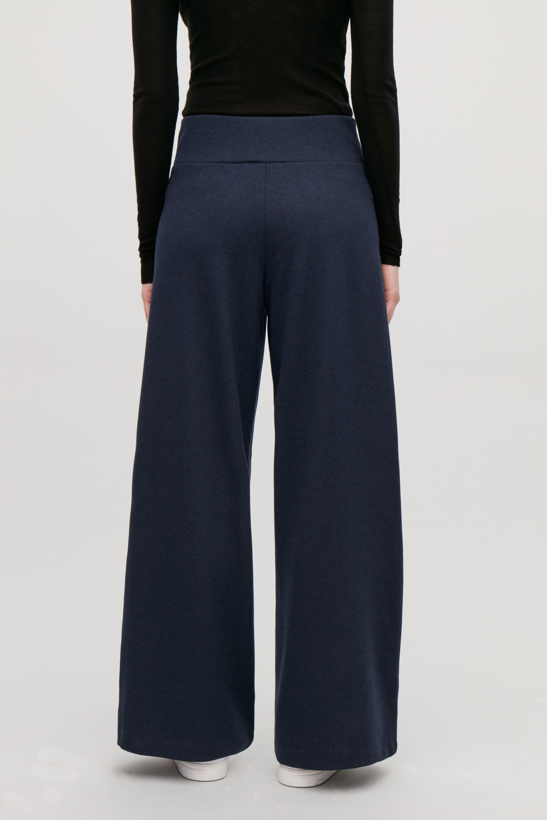 Model side image of Cos cotton-wool high-waist trousers in blue