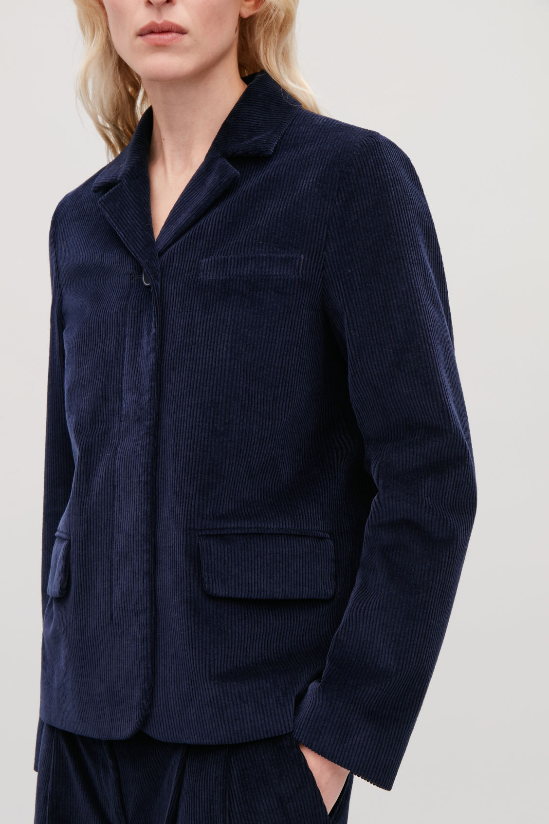 Model side image of Cos workwear corduroy blazer in blue